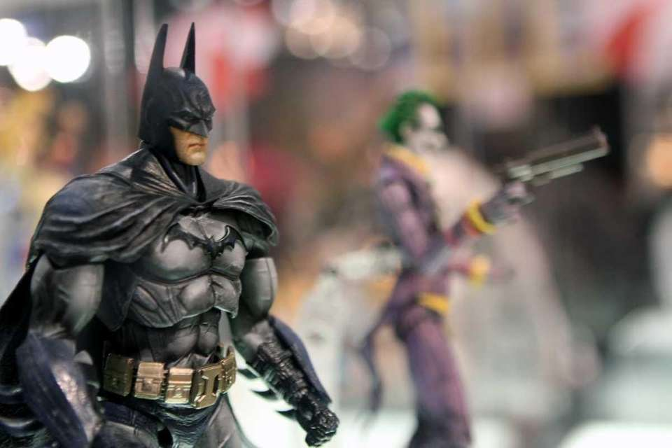 Batman and Joker toys are displayed at New