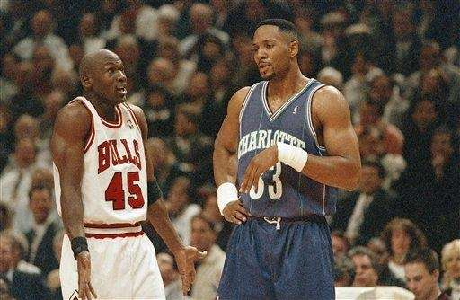 Chicago Bulls' Michael Jordan, left, and Charlotte Hornets'