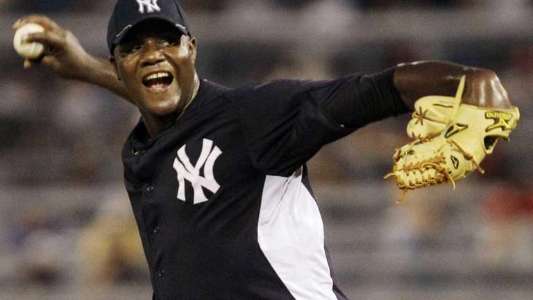 Yankees starting pitcher Michael Pineda winds up in