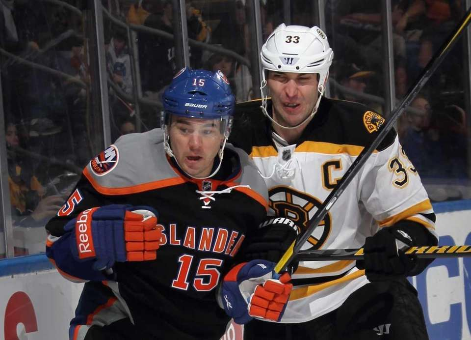 Zdeno Chara of the Bruins rides P.A. Parenteau