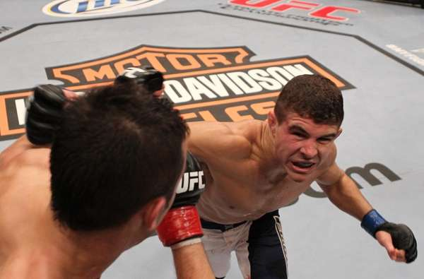 Al Iaquinta, right, lands a punch on Myles