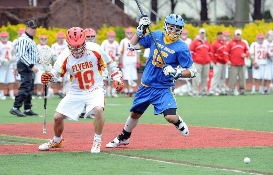 West Islip's #15 Anthony Santo, right, chases down