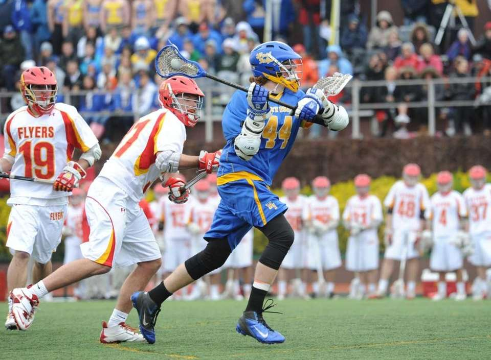 West Islip's #44 Tom Moore shoots during action.