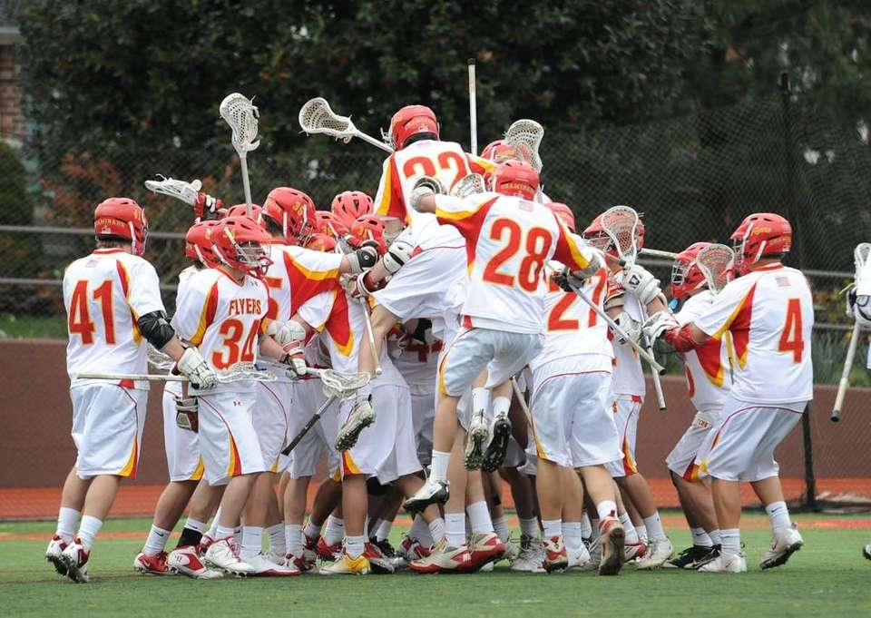 Chaminade teammates celebrate after beating West Islip 7-6
