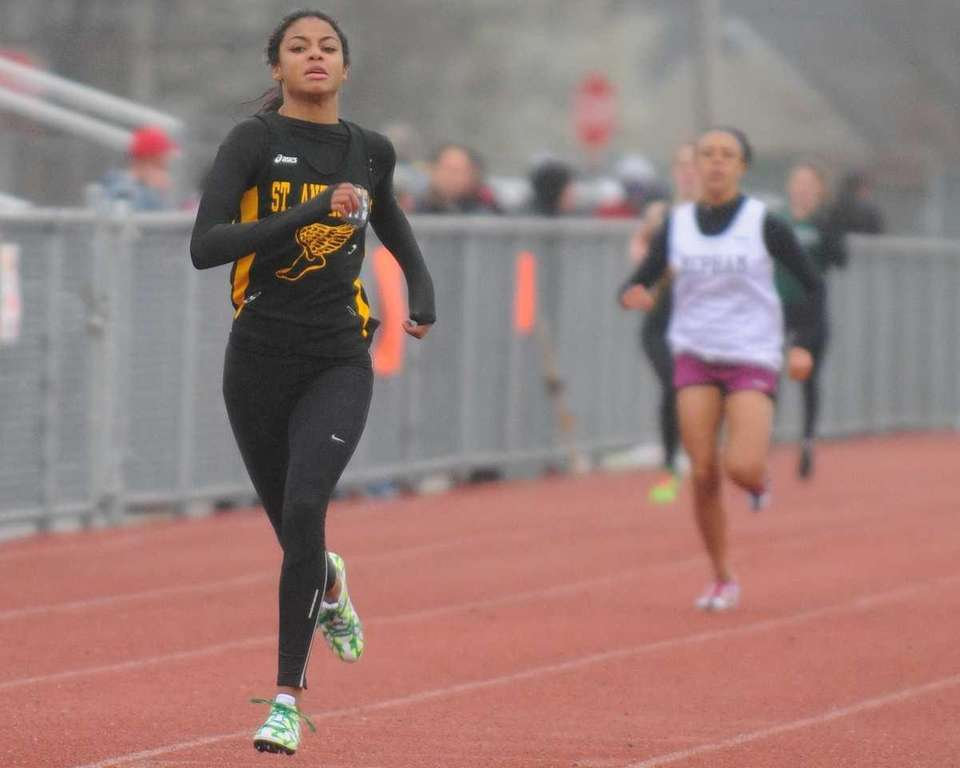 St. Anthony's High School senior Olicia Williams races