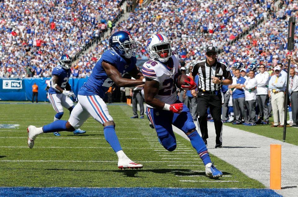 Devin Singletary #26 of the Buffalo Bills runs
