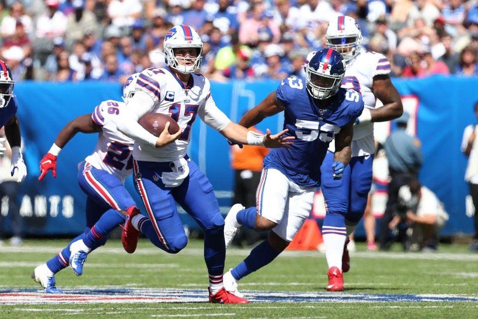 Josh Allen #17 of the Buffalo Bills scramble