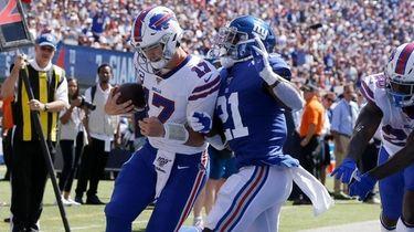 Josh Allen of the Buffalo Bills runs in