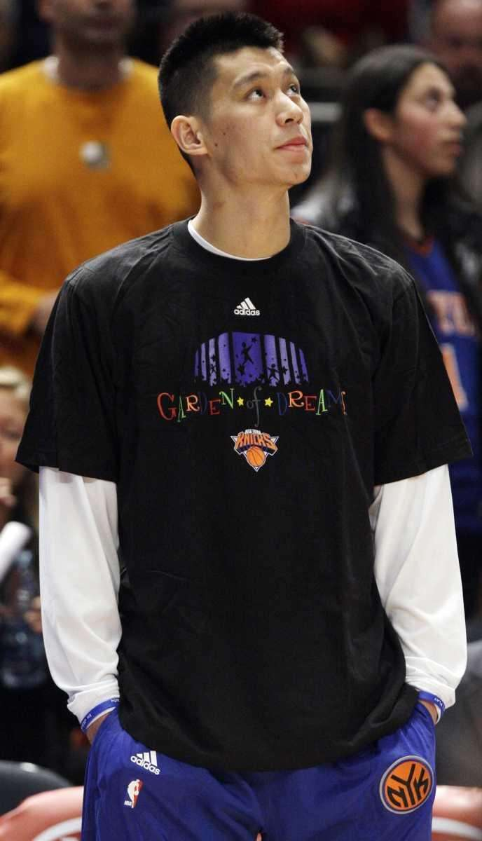 New York Knicks' Jeremy Lin looks on before