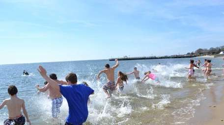 More than 100 people ran into the ocean