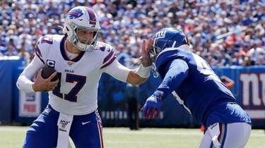 Josh Allen of the Bills eludes Alec Ogletree