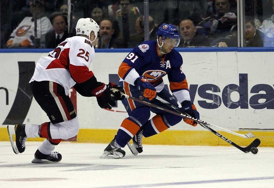 The Islanders' John Tavares controls the puck against