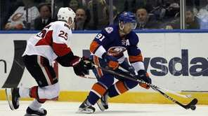 The Islanders' John Tavares controls the puck against