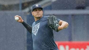 Yankees pitcher Dellin Betances warms up in the