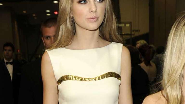 Singer/song-writer Taylor Swift poses backstage at the 47th
