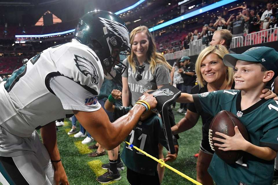 Philadelphia Eagles wide receiver Mack Hollins fist bumps