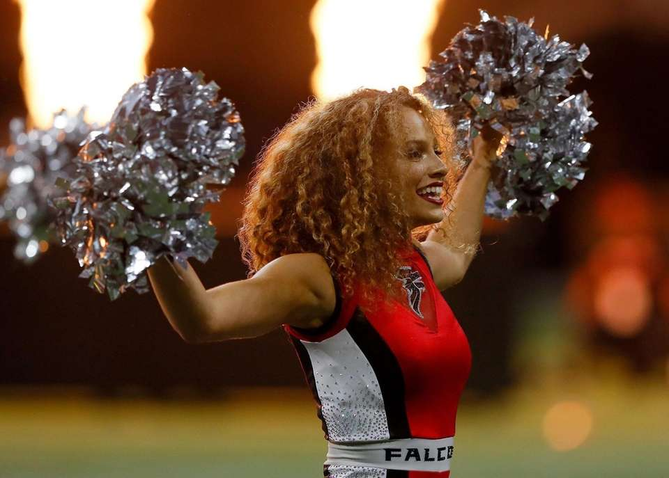 Cheerleaders for the Atlanta Falcons perform before the