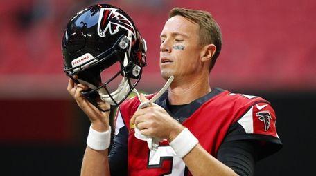 Matt Ryan of the Falcons puts his helmet