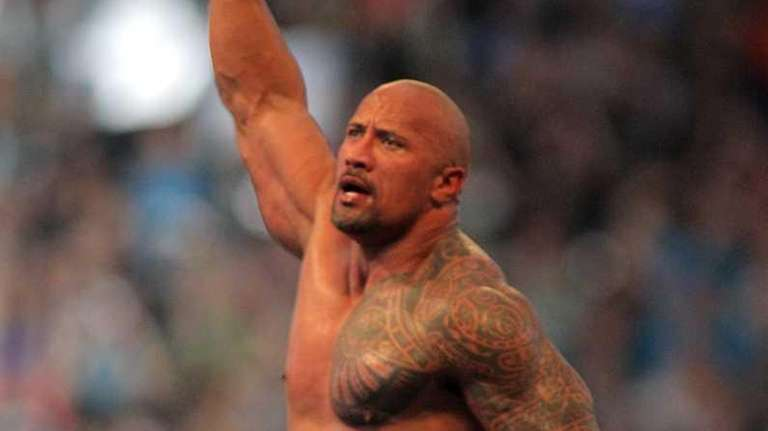 Dwyane 'The Rock' Johnson celebrates after defeating John