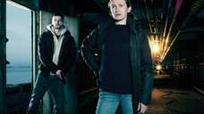 Actors Joel Kinnaman and Mireille Enos in a