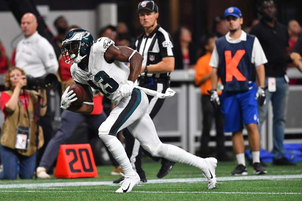 Philadelphia Eagles wide receiver Nelson Agholor runs after