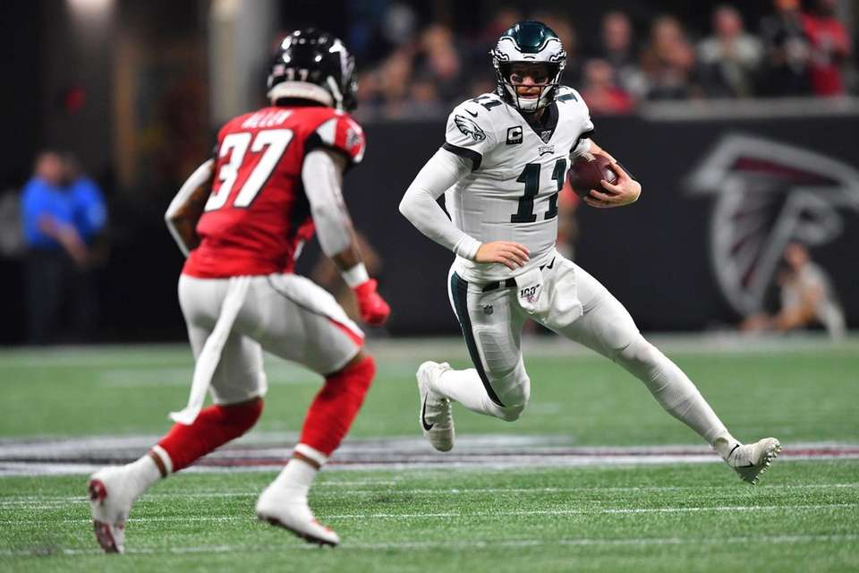 Philadelphia Eagles quarterback Carson Wentz runs out of