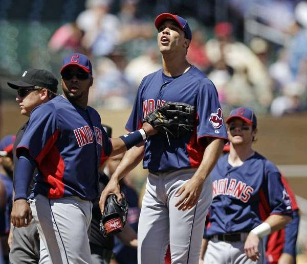 Cleveland Indians starting pitcher Ubaldo Jimenez, center, yells