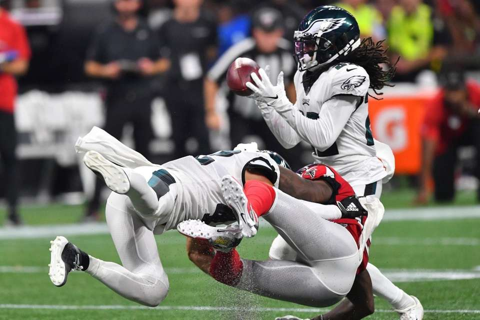 Philadelphia Eagles cornerback Sidney Jones intercepts the ball