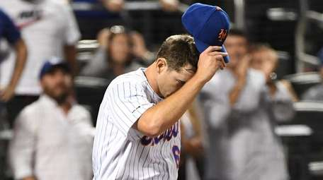 Mets relief pitcher Seth Lugo reacts after the