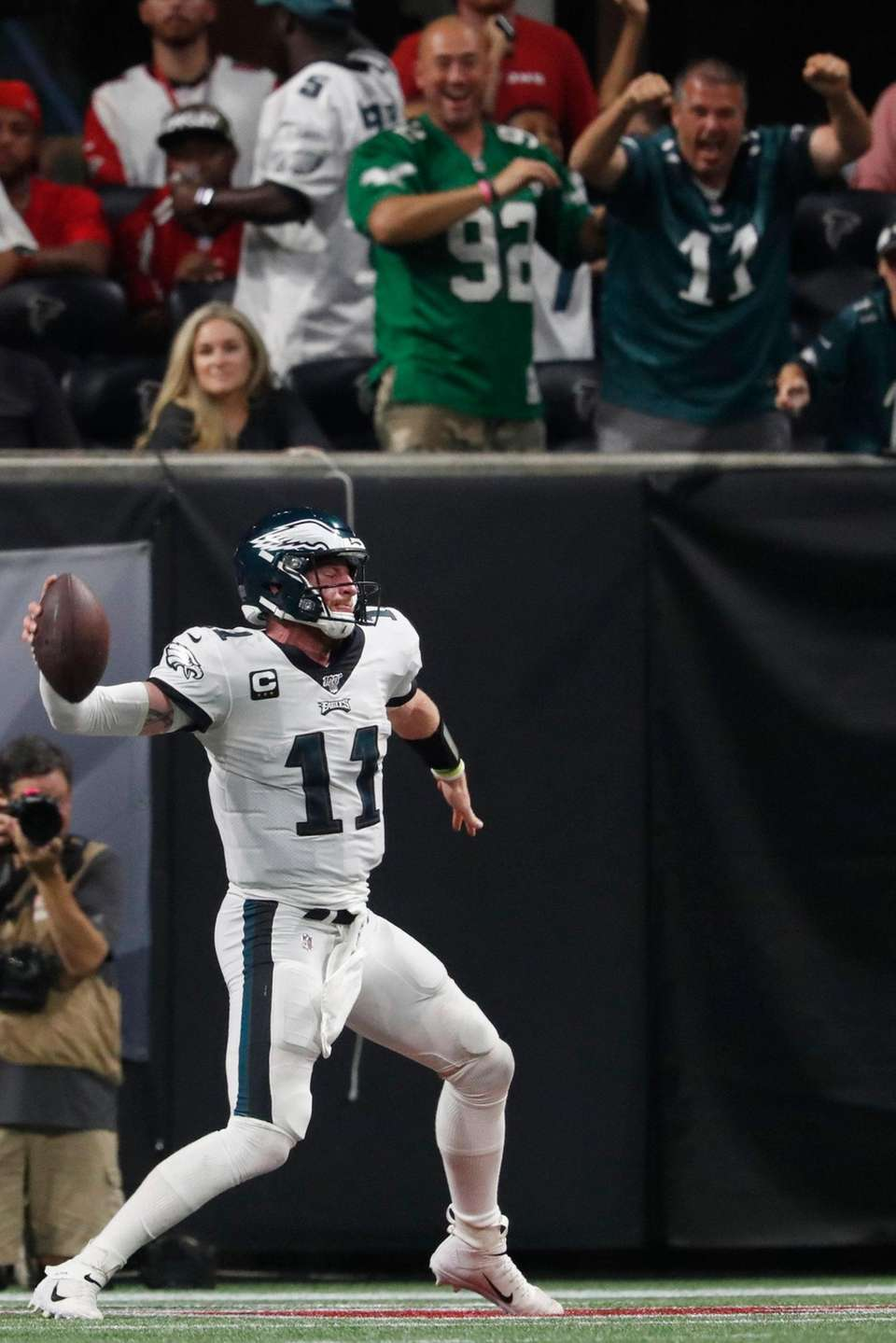 Philadelphia Eagles quarterback Carson Wentz spikes the ball