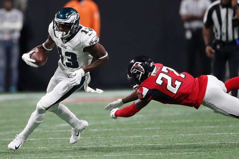 Philadelphia Eagles wide receiver Nelson Agholor moves past