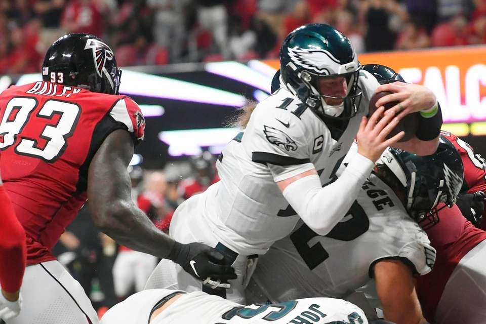 Philadelphia Eagles quarterback Carson Wentz leaps into the