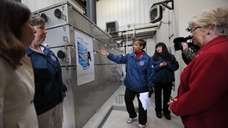 Sherrel Henry, center, EPA's Remedial Project Manager talks