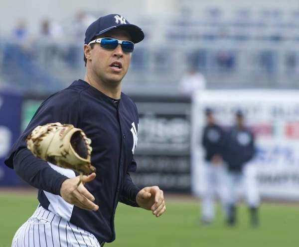Yankees' Mark Teixeira tosses his glove to sign