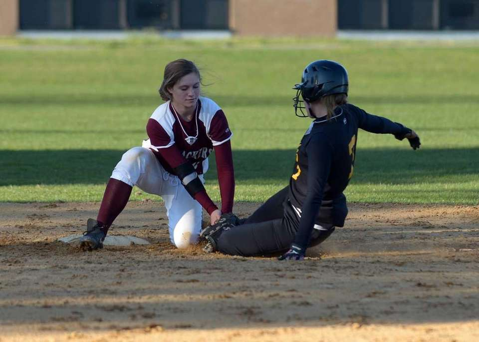 East Hampton's Ali Harned make the tag for