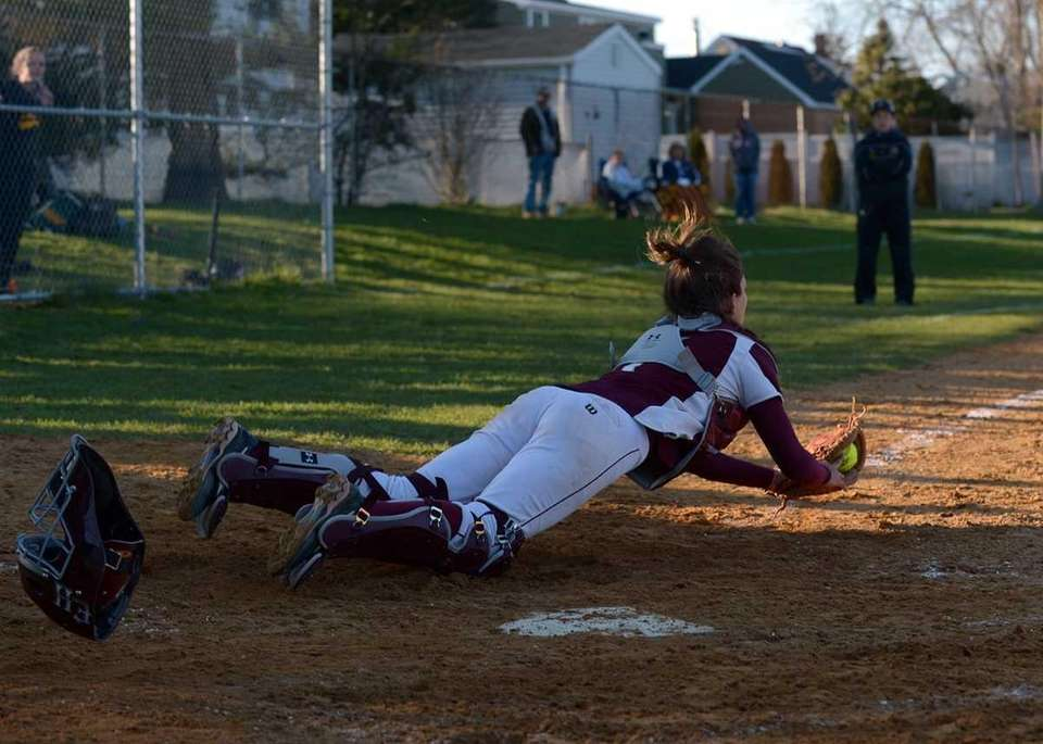 East Hampton's catcher Kathryn Hess makes a diving