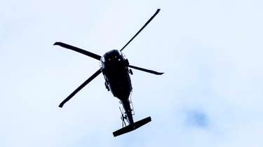 A helicoptor flies over Southold on May 11,