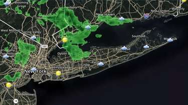 Mostly cloudy, some light rain today on Long