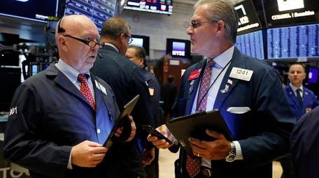 Traders John Doyle, left, and Richard Deviccaro work