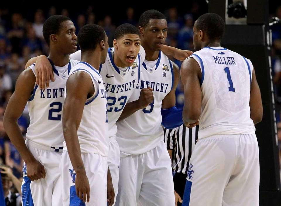 The Kentucky Wildcats huddle together during the National