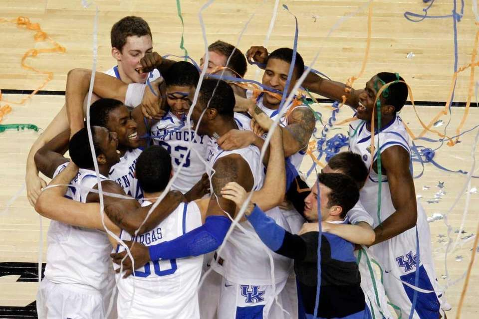 The Kentucky Wildcats celebrate defeating the Kansas Jayhawks