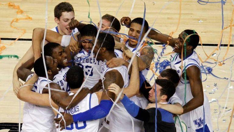 The Kentucky Wildcats celebrate defeating the Kansas Jayhawks