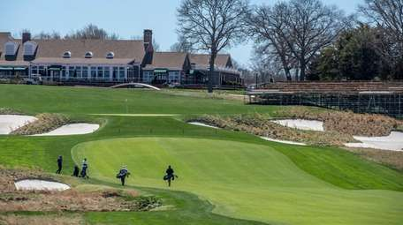 Golfers on the Bethpage Black Course.