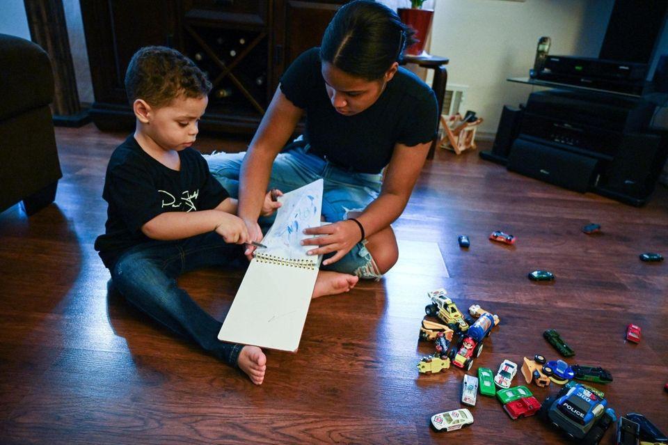 Brianna Simpkins, 16, plays with her nephew Jameek