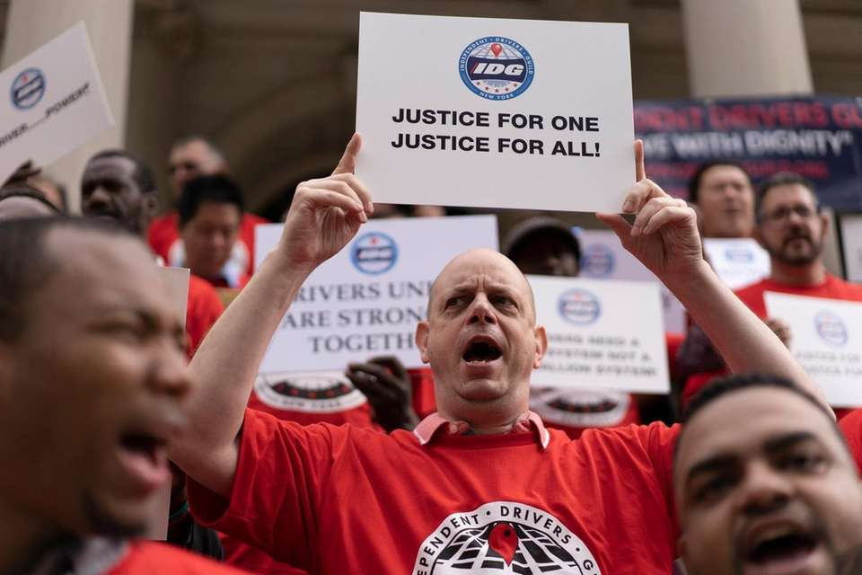 Members of the Independent Drivers Guild rally on