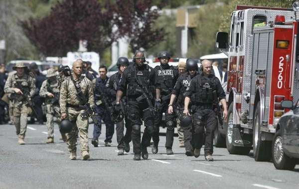 SWAT officers survey the area where police say