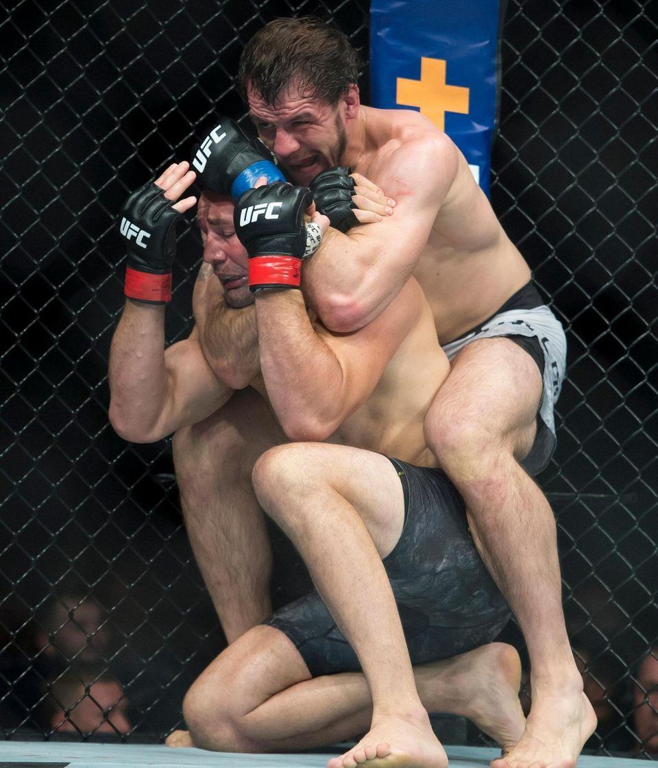 Glover Teixeira, left, fights Nikita Krylov during their