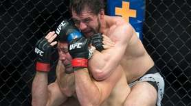 Glover Teixeira, left, fights Nikita Krylov during their