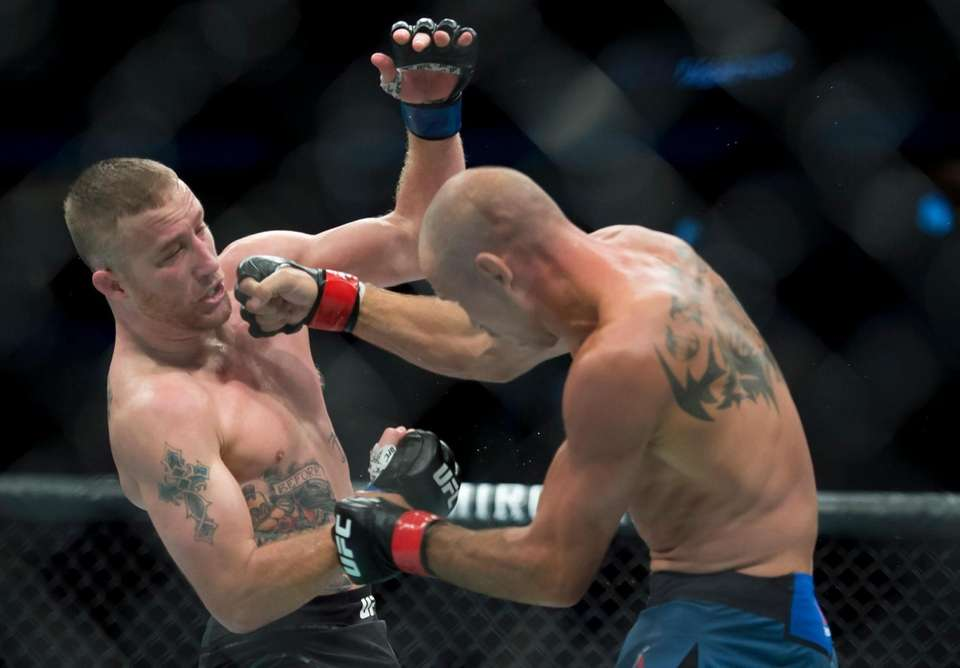 """Donald """"Cowboy"""" Cerrone, right, fights Justin Gaethje during"""