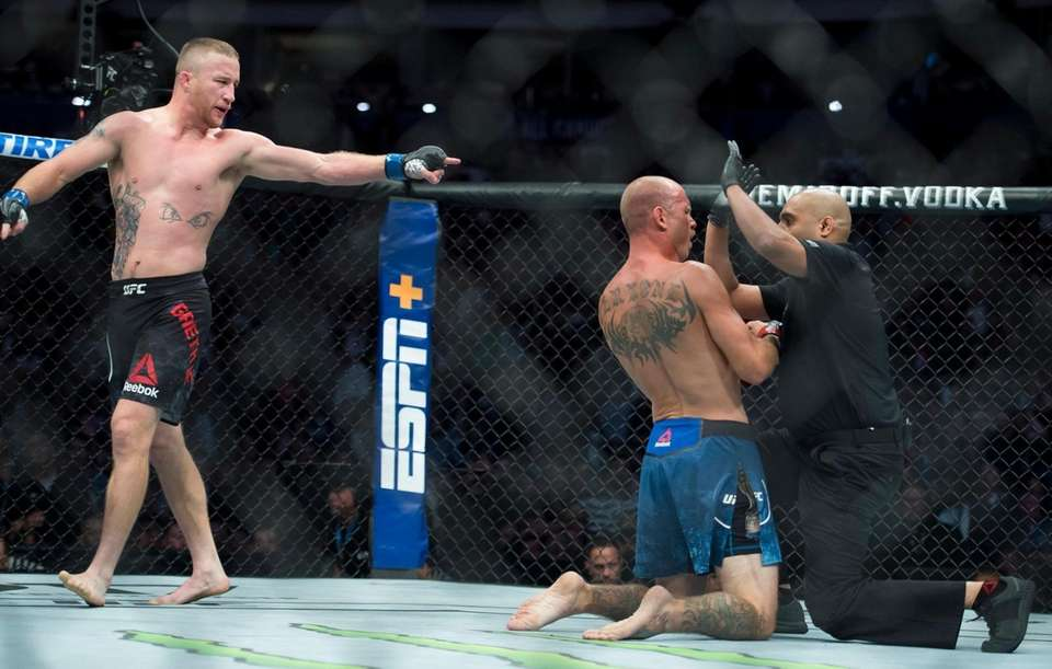 Justin Gaethje looks on as the referee checks